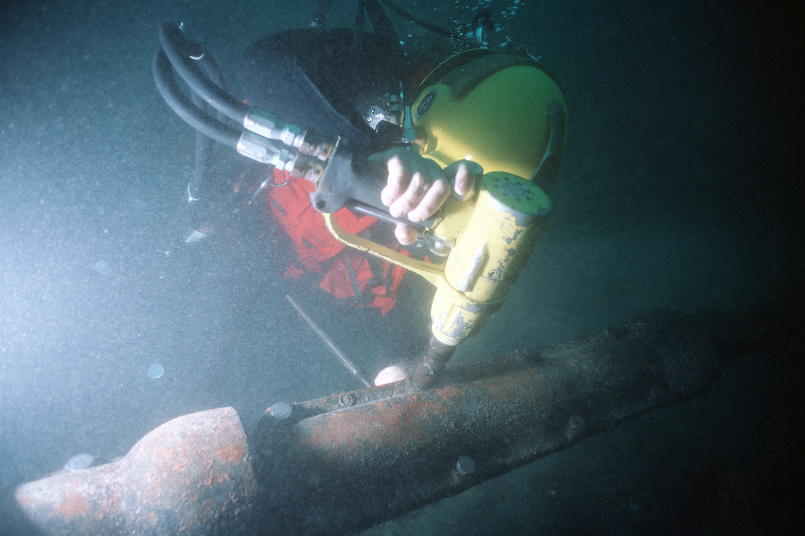 underwater impact wrench to tighten bolts on installed split pipe used to protect cable on the ocean floor.